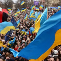 TOPSHOTS Pro-European protesters wave Ukrainian flags during a rally in the western Ukrainian city of Lviv on November 28, 2013. An EU summit to cap years of effort to bring ex-Soviet states into the Western fold opens with its ambitions dented on November 28 after Ukraine, the biggest prize, balked at the last moment under Russian pressure. Kiev's surprise decision to scrap a landmark political and trade accord with the European Union just days before has set off a war of words between East and West reminiscent of the Cold War and sparked some of the biggest protests in Ukraine in a decade.   AFP PHOTO/YURIY DYACHYSHYNYURIY DYACHYSHYN/AFP/Getty Images ORG XMIT: -